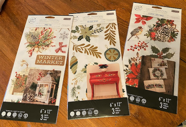 Photo of three small Christmas Decor Transfer packages.