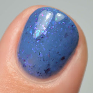 blue nail polish with flakies