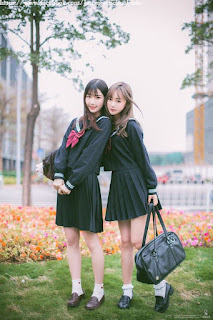 uniformes negros mujeres Asiáticas