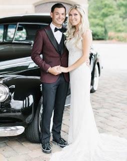 Katelyn Sweet & her husband Kyle Larson on their wedding dress