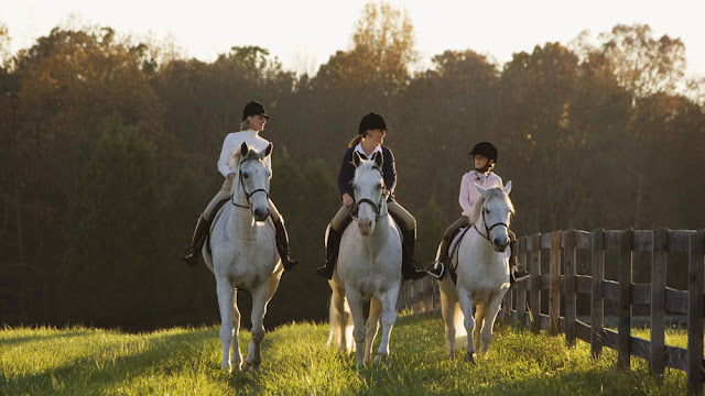 three generations of women on horseback
