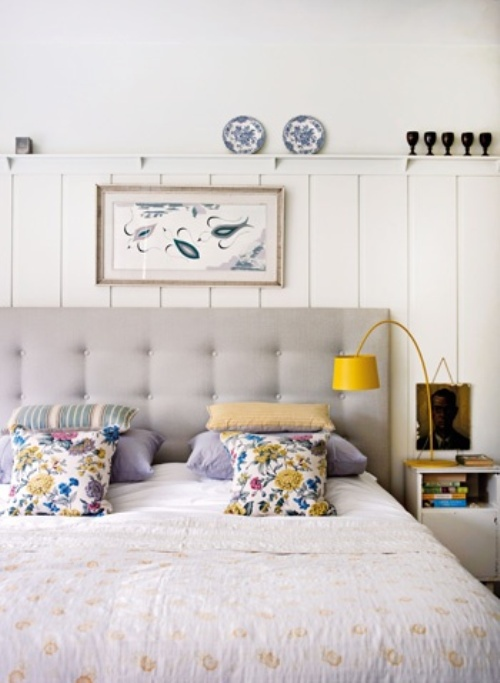 elegant grey bedroom with yellow and floral print details
