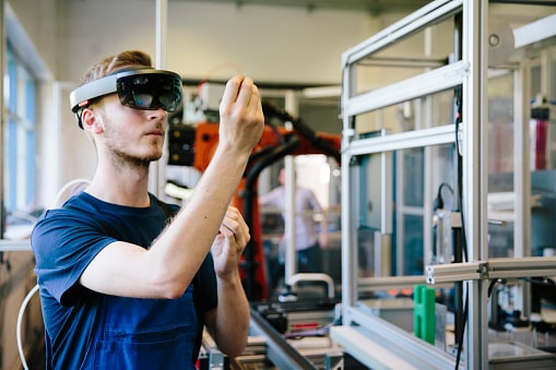 A young boy view through a VR in a science lab - Scope of Robotics