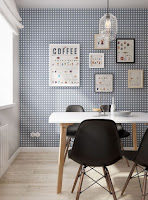 Scandinavian dining room decoration with wallpaper and black dining chairs