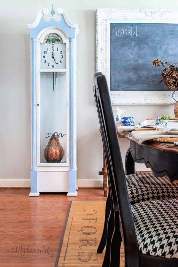 painted grandfather clock with copper gourd