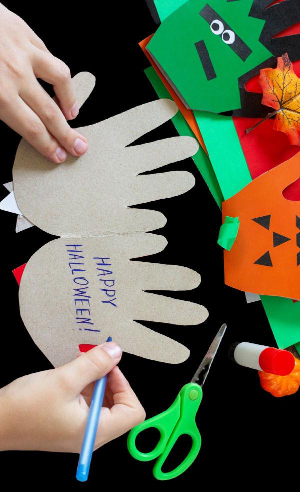"Turn kids hand prints into adorable Halloween art and make ""SPOOKY HANDS"" #halloween #halloweencrafts #handprintcraftsforkids #spookyhands #growingajeweledrose #activtiesforkids"