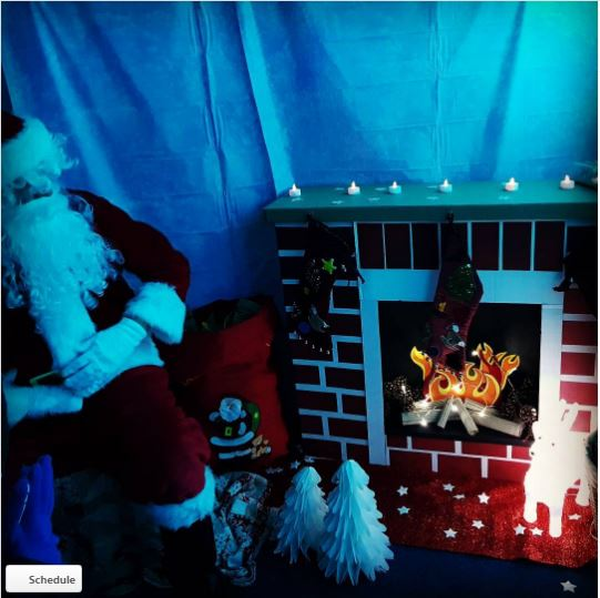 Santa in is Grotto with a homemade fireplace