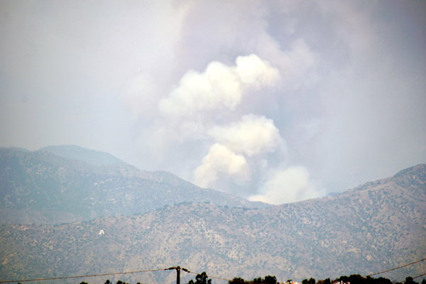 A smoke cloud emerges as the Bobcat Fire flares back up in the San Gabriel Mountains...as seen from the city of Industry in California on September 19, 2020.