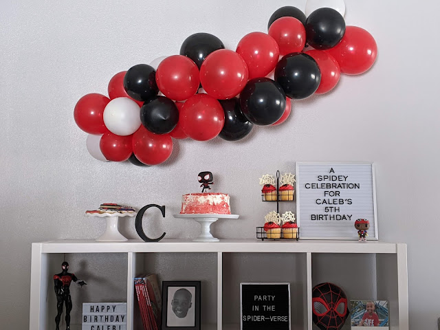 dessert table and balloon garland for spidey celebration for Caleb's 5th birthday
