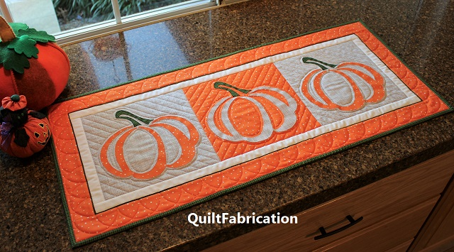 Pumpkin applique runner by QuiltFabrication