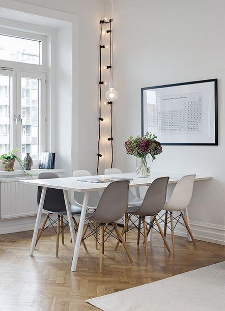 mesa-branca-com-cadeiras-charles-eames
