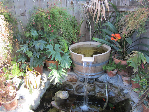 Backyard barrel fountain design, Fountain design, backyard design ideas, backyard fountain design