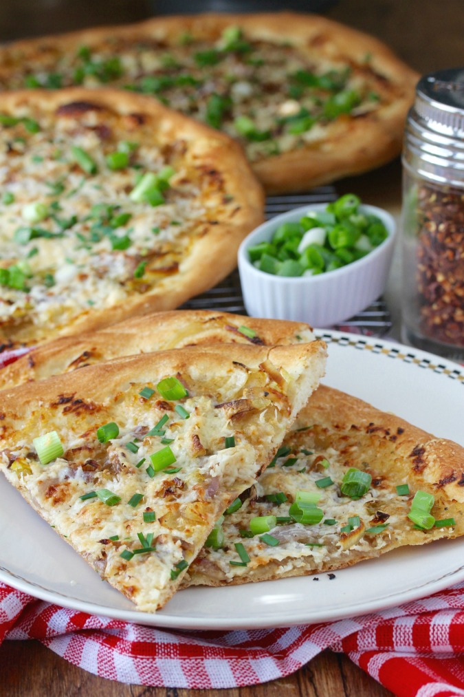 This Six Onion Pizza recipe is both sweet and savory at the same time. It's the perfect pizza for your spring onion bounty.