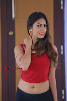 Telugu Actress Nishi Ganda Stills in Red Blouse and Black Skirt at Tik Tak Telugu Movie Audio Launch .COM 0331.JPG