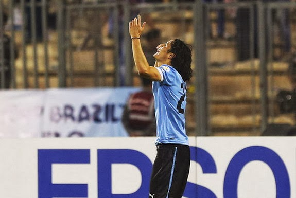 Uruguay striker Edinson Cavani celebrates after scoring a goal against Jordan