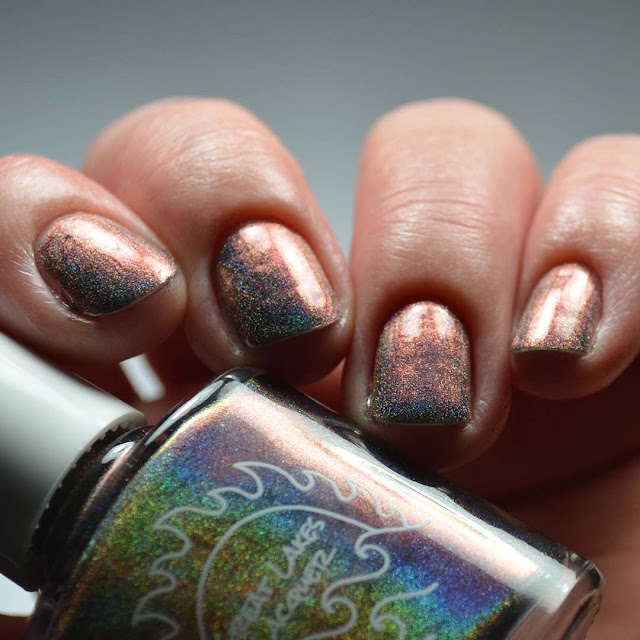 holographic grey to peach nail polish swatch in low light