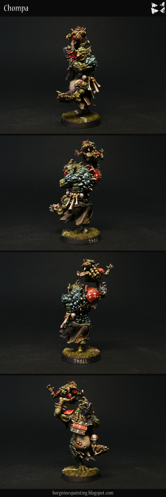 Blood Bowl Troll miniature from Games Workshop, painted with green skin, blue scales and red armor, holding a goblin, getting prepared to throw him - visible from several angles.