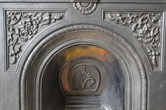 restored victorian fireplace with fireback and soot hatch