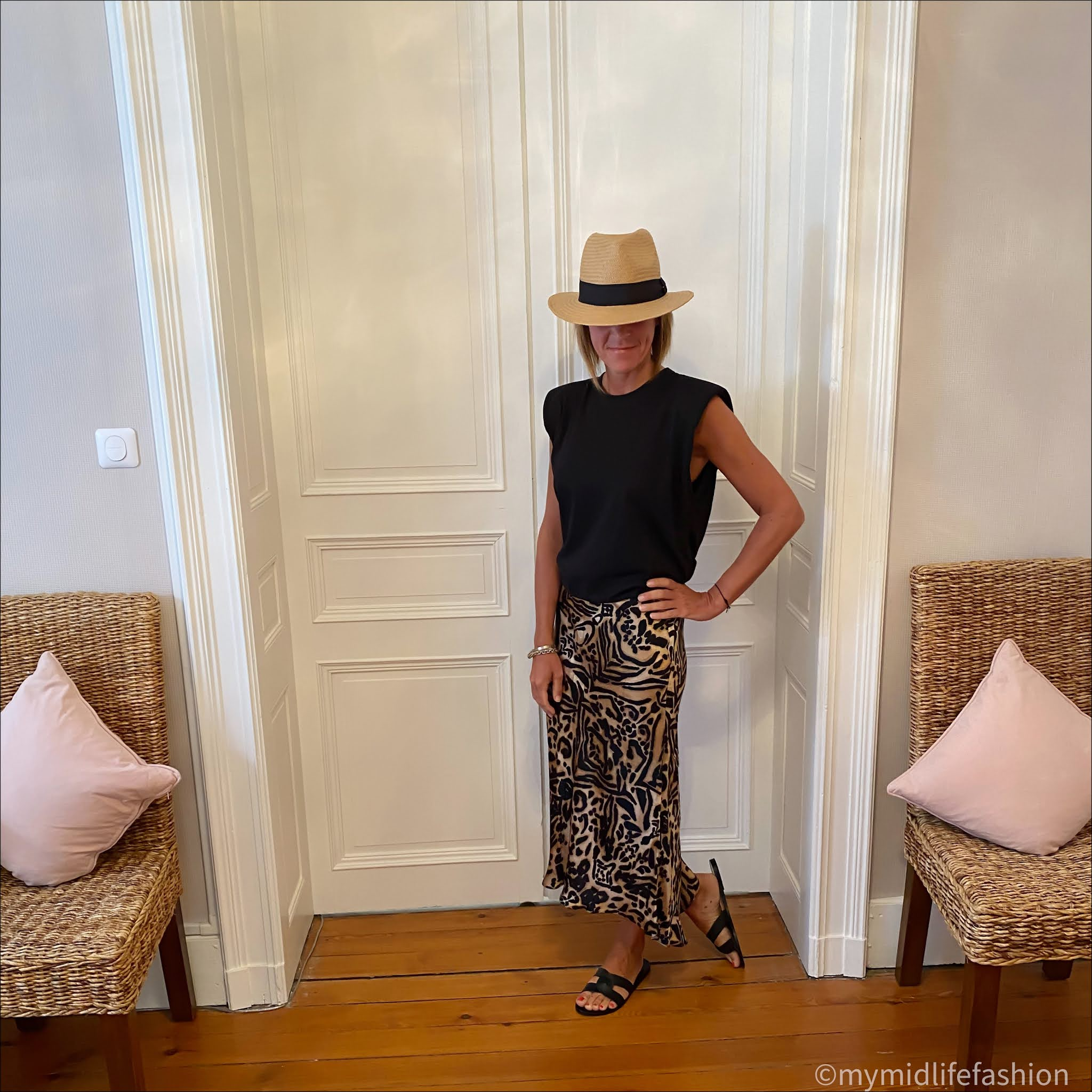 my midlife fashion, H&M straw Panama hat, zara t-shirt with shoulder pads, raey dipped hem silk maxi skirt, Ancient Greek desmos leather sliders