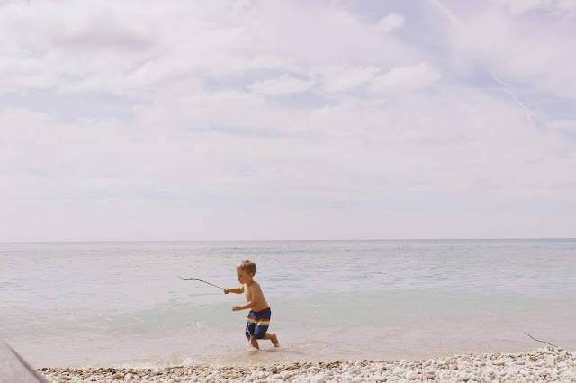 Child playing on Lake Michigan beach