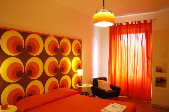 Dormitorios color naranja colores en casa for Dormitorio naranja