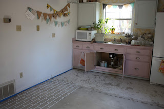 kitchen with unfinished concrete floor