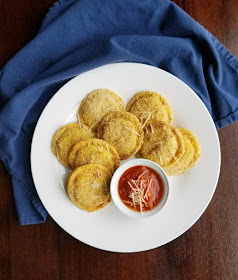 plate filled with air fryer toasted ravioli and tomato sauce