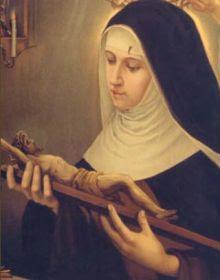 En la imagen Santa Rita comtemplando un crucifijo.