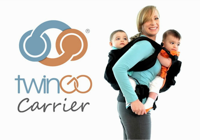 a baby twin baby carrier for one child on the front one on the back suitable for babies four months plus with a good head hold