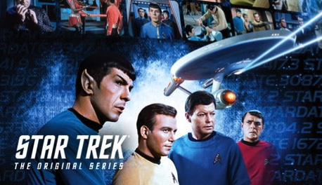 Promo image of Spock, Kirk, Bones, and Scotty with the Enterprise above them