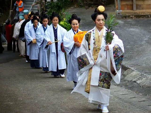 women wearing white robes in procession