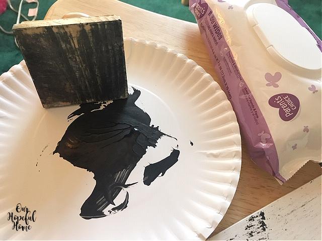 layering block black acrylic paint paper plate