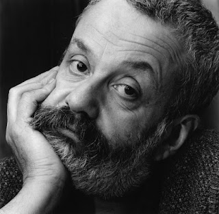Black and white photo portrait of Mike Leigh