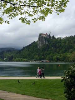 Pic of Lake Bled from lakeside with castle on the hill
