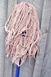 old string mop wet