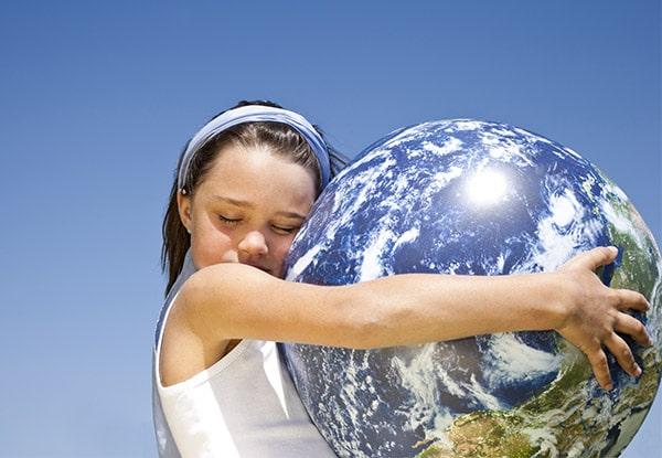 Girl hugging a globe