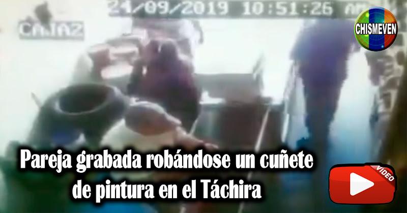 Pareja grabada robándose un cuñete de pintura en el Táchira