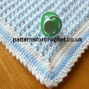 http://www.craftsy.com/pattern/crocheting/home-decor/pfc50-crib-blanket-baby-crochet-pattern/123831?SSAID=924082
