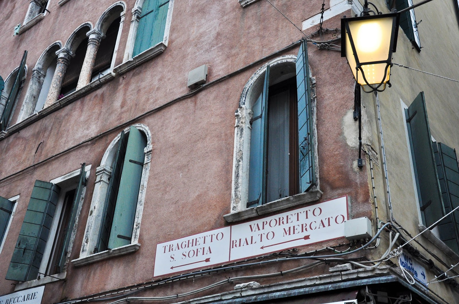 Sign pointing to a traghetto stop, Venice, Italy