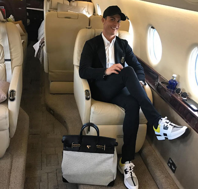 Hit or miss? Ronaldo rocks sneakers with suit on private jet