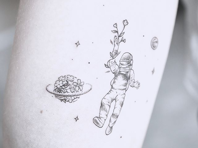 Astronaut floating tattoos