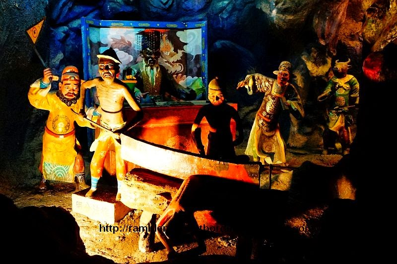 Body being sawn off in the 6th Court, Haw Par Villa, Singapore