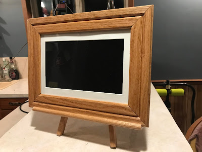 Add a touch of class with a picture frame with this easel