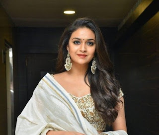 Keerthy Suresh in White Dress with Cute Smile at Pandem Kodi 2 Pre Release Event in Hyderabad
