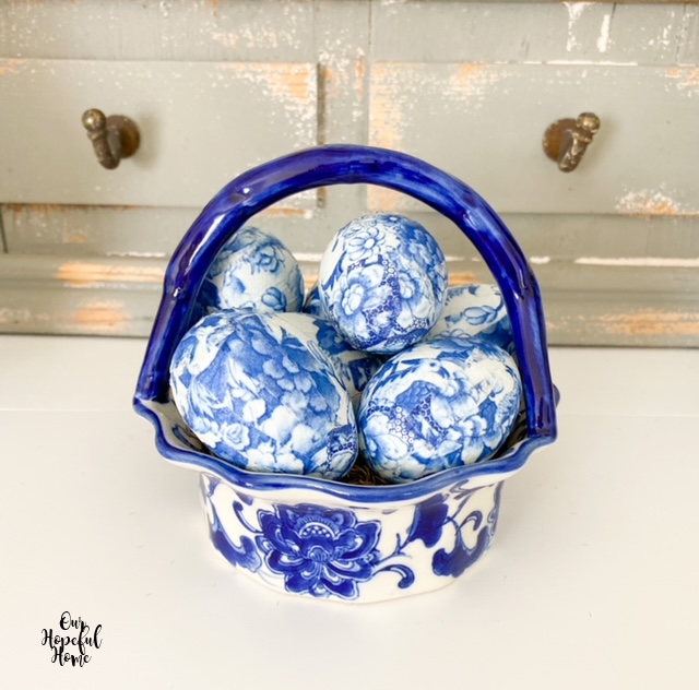 blue handled fluted china bowl blue white eggs