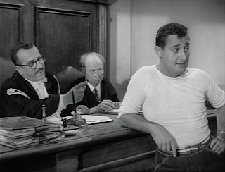 Sordi (right) in a scene from his 1954 film An American in  Rome, which established him as a comic character actor