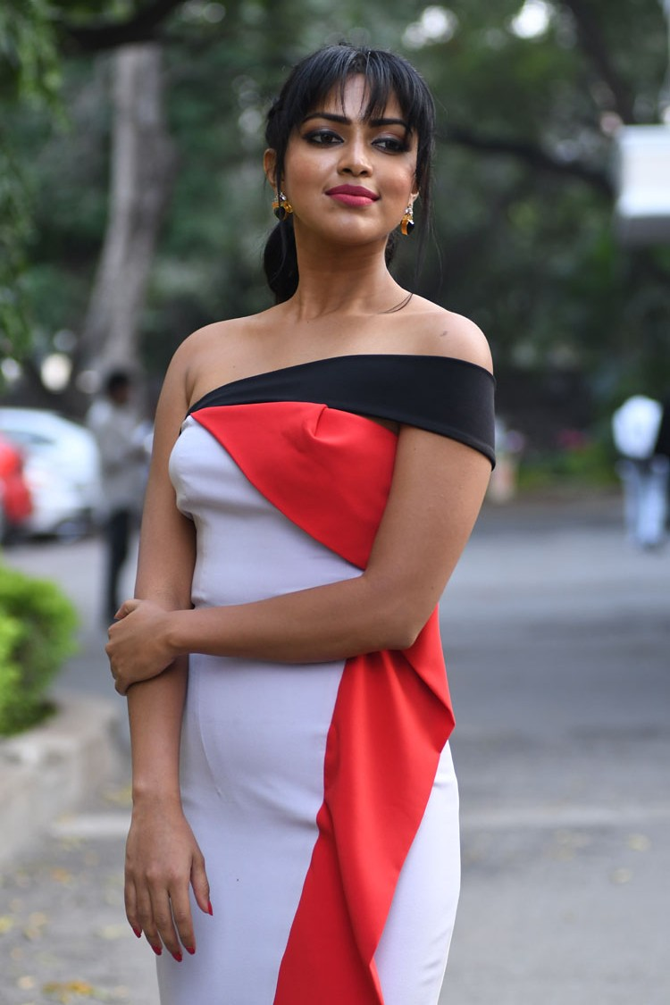 Amala Paul in a Beautiful Sleevelss Red White Long Gown pormoting her movie Dongodochadu