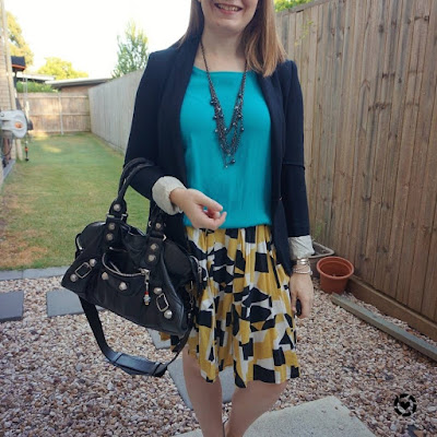 awayfromblue Instagram | turquoise and pleated mustard print skirt and blazer autumn business casual office outfit with Balenciaga part time bag