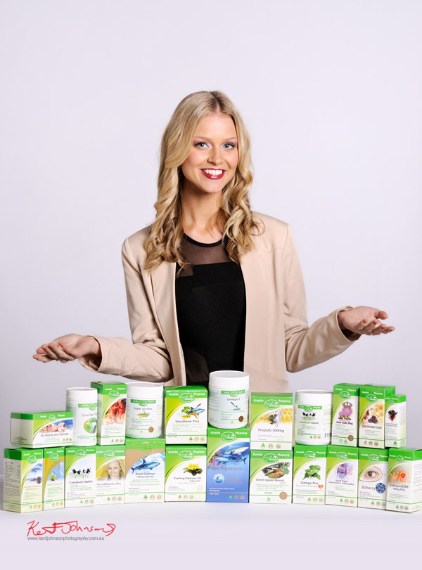 Commercial product and promotional photography with Miss Universe Australia Renae Ayris, table top shot with health products and model.