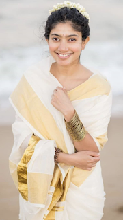 Sai pallavi latest white saree golden blouse Malayalam traditional saree Navel Queens